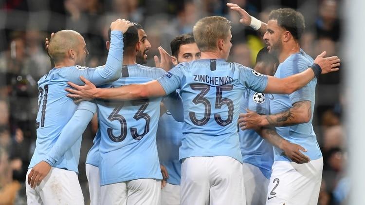 Paul ELLIS / AFP El equipo celebra la victoria