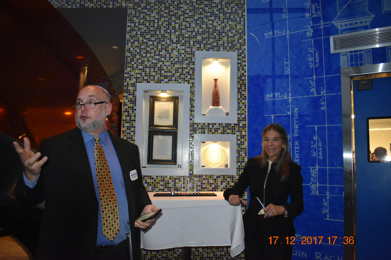As the celebration begins, Abe Bonowitz, former Field Director of New Jerseyans for Alternatives to the Death Penalty and current Director of Death Penalty Action, lights the Chanukah candles with Sharon M. Elghanayan, wife of former Governor Jon Corzine.