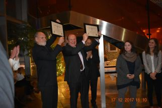 Governor Corzine and Senator Lesniak hold up awards, honoring them for their tireless efforts to end the death penalty in New Jersey