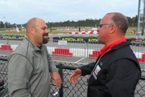 Seesemann and MAXSpeed's Richard Boisclair discuss 2014 while enjoying the racing at the Rotax Max Challenge Grand Finals