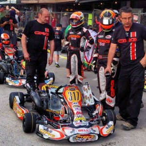 CRG karts lined up on the grid at the Lone Star Grand Prix, ready to take to the track