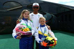 Lewis Hamilton with FKS racers Bryony King and Caden McQueen