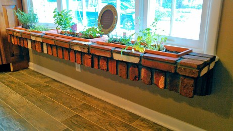 Custom masonry brick planter in kitchen bay window.