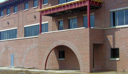 Commercial masonry brick office building with walk-through brick arch.
