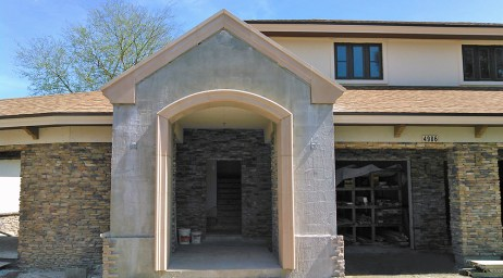 Masonry cast stone trim and gable.