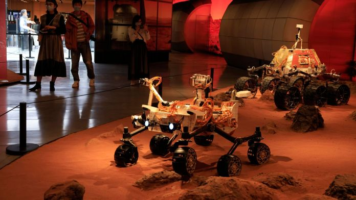 An exhibition in Beijing has been educating visitors about the ambitious mission to the Red Planet. Pic: AP