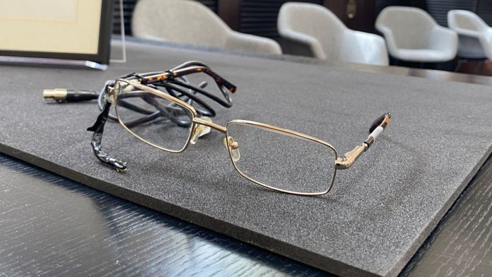 Professor Hawking's glasses, which had a sensor to pick up cheek movements to help with communication. Pic: Science Museum Group