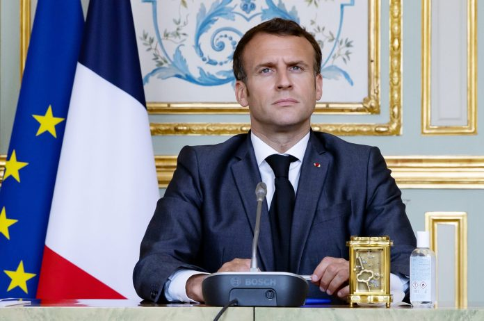 French President Emmanuel Macron slapped in face, two people arrested