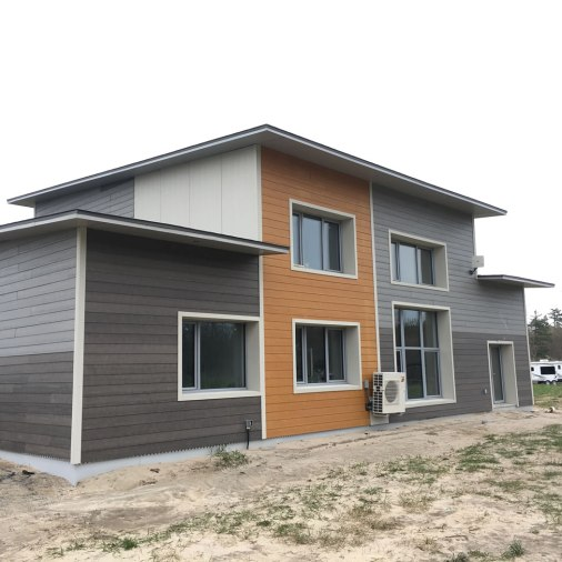 Wood engineered siding on the EkoModel Home