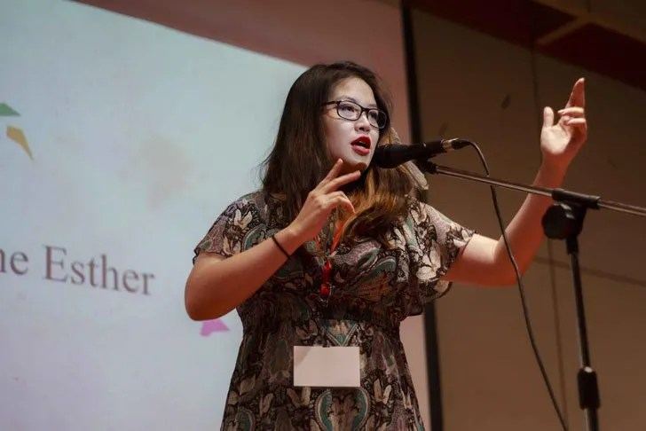 UCSI's English Language & Communication (ELC) degree student, Gwendoline Esther Hay Ai Yin mimics a gunman during her poetry slam performance. Image courtesy of UCSI University