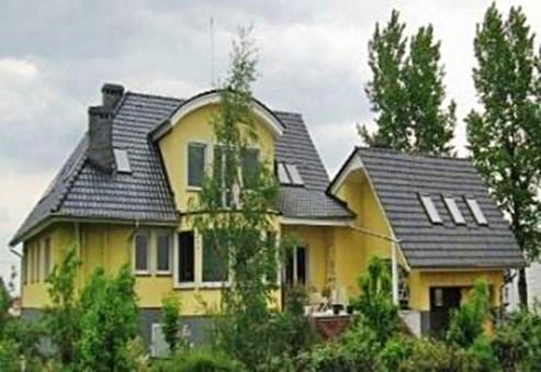 widok od strony ogrodu na willę we Wrocławiu do sprzedaży