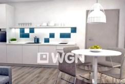 zdjęcie przedstawia jadalnię oraz kuchnię w apartamencie do sprzedaży nad morzem