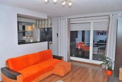 rzut z innej perspektywy na salon w apartamencie w Szczecinie na sprzedaż
