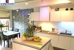 zdjęcie przedstawia komfortową kuchnię w apartamencie na wynajem w Szczecinie