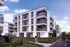 zdjęcie przedstawia osiedle z apartamentowcami w okolicy Poznania, w którym znajduje się oferowany do sprzedaży apartament