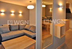 zdjęcie prezentuje fragment salonu oraz przedpokój w apartamencie do wynajęcia w Szczecinie