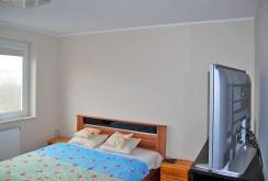 ekskluzywna sypialnia w apartamencie do sprzedaży w Olsztynie