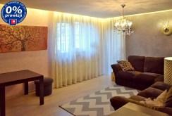 salon z innej perspektywy w luksusowym apartamencie do sprzedaży w Legnicy