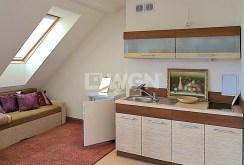 nowocześnie umeblowana i urządzona kuchnia w apartamencie w Szczecinie na wynajem