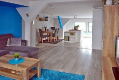 zdjęcie prezentuje salon w luksusowym apartamencie na sprzedaż w Szczecinie