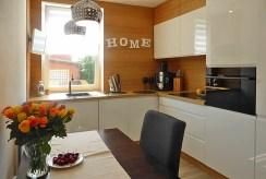 nowoczesna i komfortowa kuchnia w ekskluzywnym apartamencie w okolicach Kwidzyna na sprzedaż