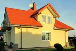 widok od strony ogrodu na luksusową willę w okolicach Rzeszowa na sprzedaż