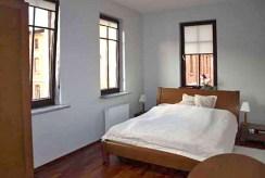 zaciszna, elegancka i prywatna sypialnia w luksusowym apartamencie w Szczecinie na sprzedaż