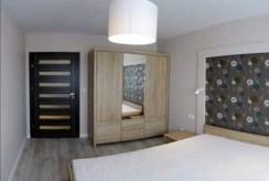widok na sypialnię w luksusowym apartamencie w Szczecinie na wynajem
