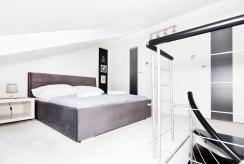 widok na elegancką sypialnię w luksusowym apartamencie do sprzedaży w Szczecinie
