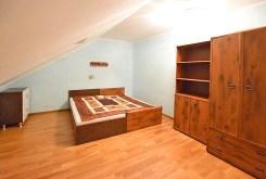 fragment eleganckiej, zacisznej sypialni w luksusowym apartamencie w Suwałkach na wynajem