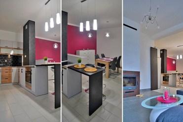 od lewej salon, aneks kuchenny oraz kominek w luksusowym apartamencie do wynajmu w Katowicach