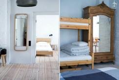widok na sypialnię oraz przedpokój w luksusowym apartamencie nad morzem na sprzedaż