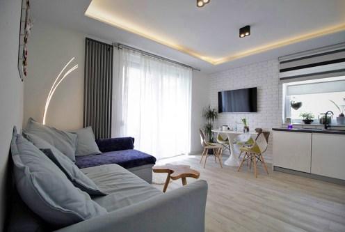 nowoczesny salon w ekskluzywnym apartamencie do sprzedaży w Krakowie