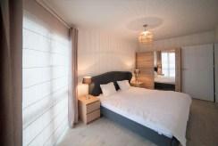 zaciszna, elegancka sypialnia w luksusowym apartamencie w Szczecinie na sprzedaż