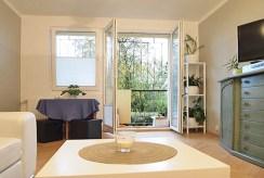 zdjęcie przedstawia komfortowy salon w luksusowym apartamencie w Szczecinie na sprzedaż