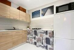 funkcjonalnie zabudowana kuchnia w luksusowym apartamencie do wynajmu Gliwice (okolice)