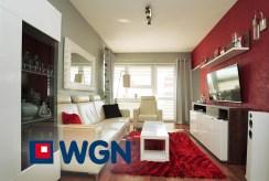 zbliżenie na pokój dzienny w luksusowym apartamencie na sprzedaż Elbląg