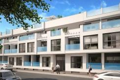 na pierwszym planie apartamentowiec, gdzie mieści się oferowany do sprzedaży ekskluzywny apartament hiszpania (costa blanca, torrevieja)