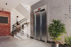 designerska klatka schodowa w budynku, gdzie znajduje się oferowany na sprzedaż ekskluzywny apartament Legnica