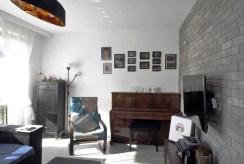 wytworny pokój dzienny w luksusowym apartamencie na sprzedaż Malbork