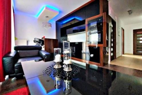 nowoczesny design pokoju dziennego w ekskluzywnym apartamencie do sprzedaży Gdańsk (okolice)