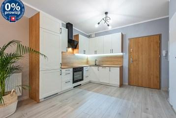 widok z salonu na aneks kuchenny w luksusowym apartamencie na sprzedaż Katowice (okolice)