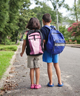 2 kids walk to school