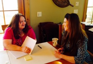 Ruth Knox, left, and Christy Hovey discuss writing goals.