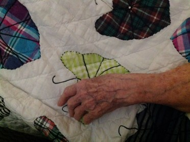 mom hands on quilt