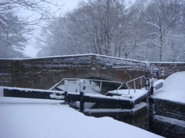 The bridge and lock gates in the snow.