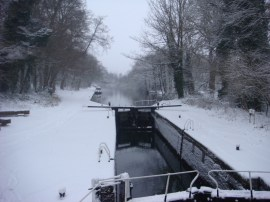 The lock on a gloomy day soon after a snow fall