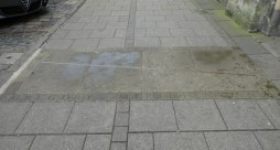 The meridian line crosses the pavement