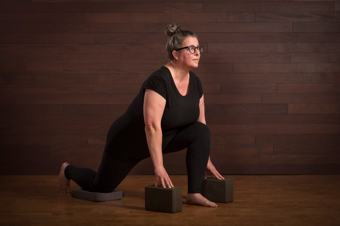 Elaine Wilson in a supported lunge posture.