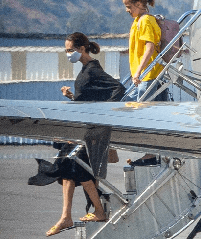Angelina Jolie dons a facemask as she arrives with her kids on a private jet in Burbank after a short trip 4